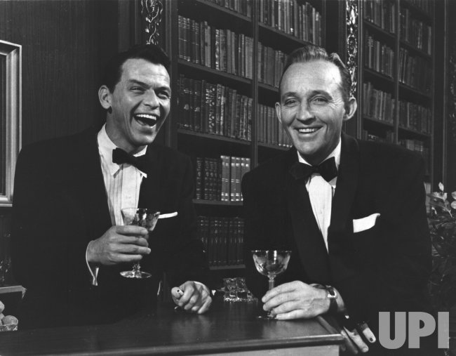 Frank Sinatra and Bing Crosby enjoy a drink together