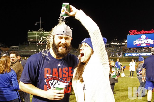 3f86bb66e86 Cubs pitcher Jake Arrieta doused by wife Brittany after 5-0 win advancing  to World Series after NLCS Game 6