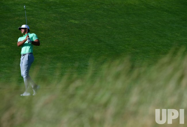 Brooks Koepka putts at the 2017 U.S. Open Golf Championship at Erin Hills in Wisconsin
