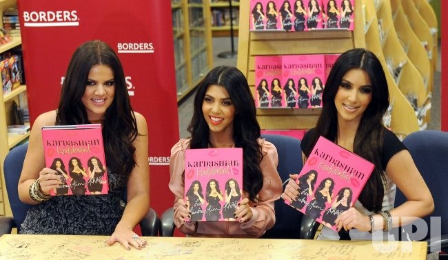 Kardashian sisters Khloe, Kourtney and Kim sign copies of their book in Los Angeles