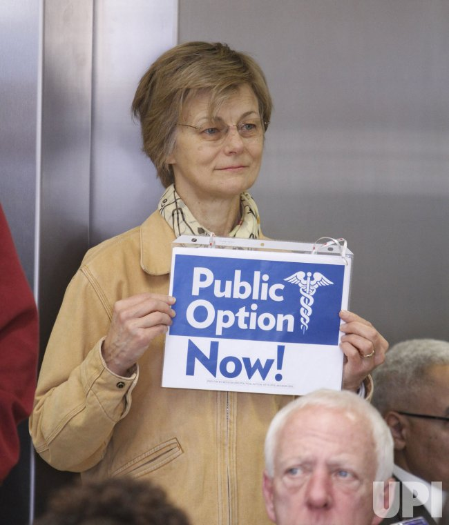 Freeman holds a sign during Sen. Burris' address in Chicago