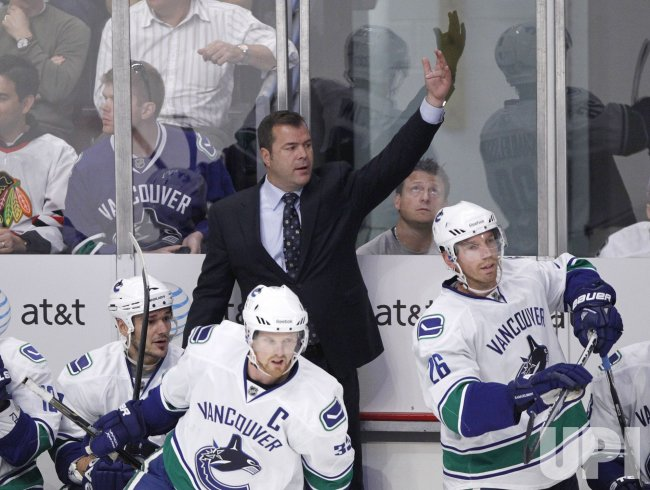 Canucks coach Vigneault signals against Blackhawks in Chicago