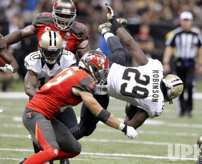 New Orleans Saints RB Khiry Robinson goes airborne against the Tampa Bay Bucs