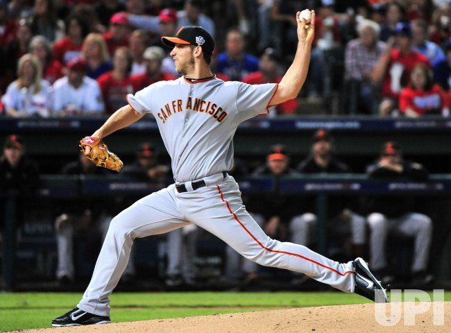 Giants' pitcher Madison Bumgarner throws in game 4 of the World Series in Texas