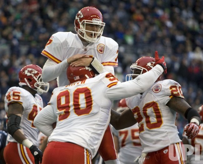Kansas City Chiefs quarterback Matt Cassel, top, and running back, Thomas Jones (R), celebrates with defensive tackle Shaun Smith after scoring a touchdown in Seattle.