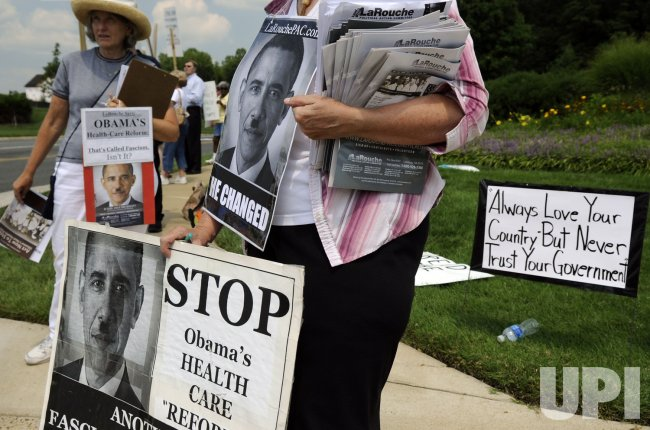 Protesters demonstrate against the healthcare reform bill outside a forum in Springfield, Virginia