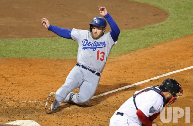 Dodgers' Max Muncy scores during World Series Game 1