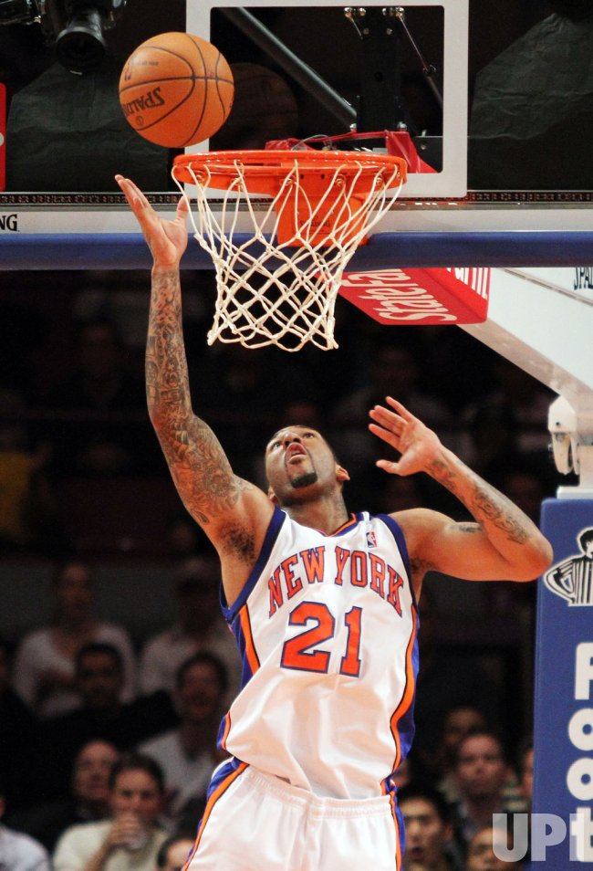 New York Knicks Wilson Chandler scoers under the basket in the first quarter against the New Orleans Hornets at Madison Square Garden in New York