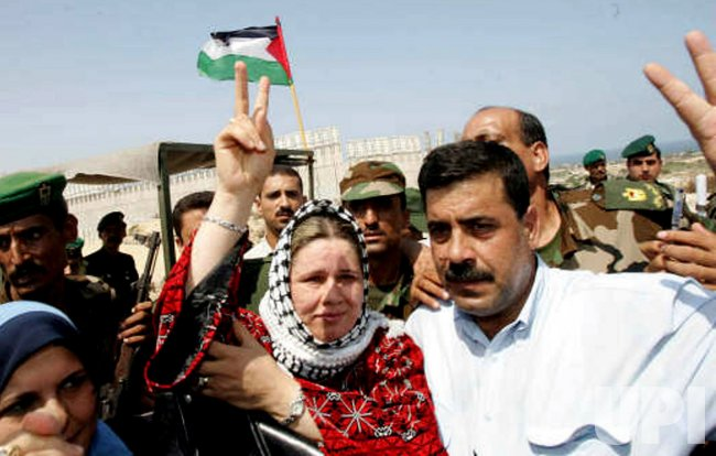 FAWA BARGHOUTI, WIFE OF JAILED PALESTINIAN UPRISING LEADER MARWAN BARGHOUTI NEAR THE ISRAELI SETTlEMENT
