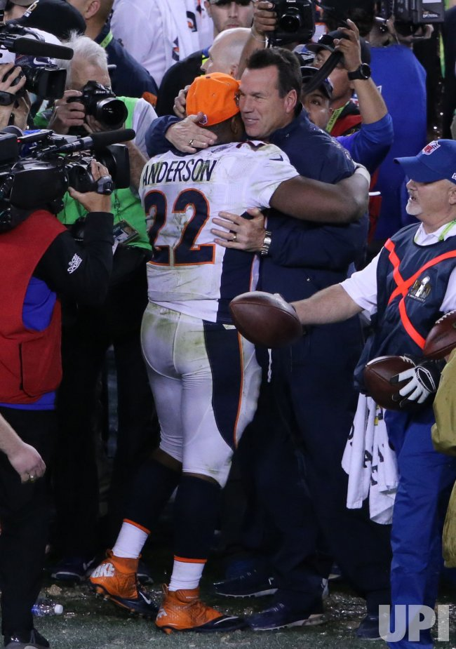 Denver Broncos C.J. Anderson hugs Head Coach Gary Kubiak after win in Super Bowl 50