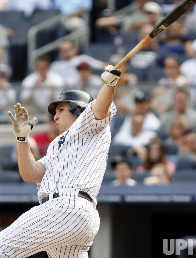 New York Yankees Mark Teixeira drives in 2 runs with a double at Yankee Stadium in New York