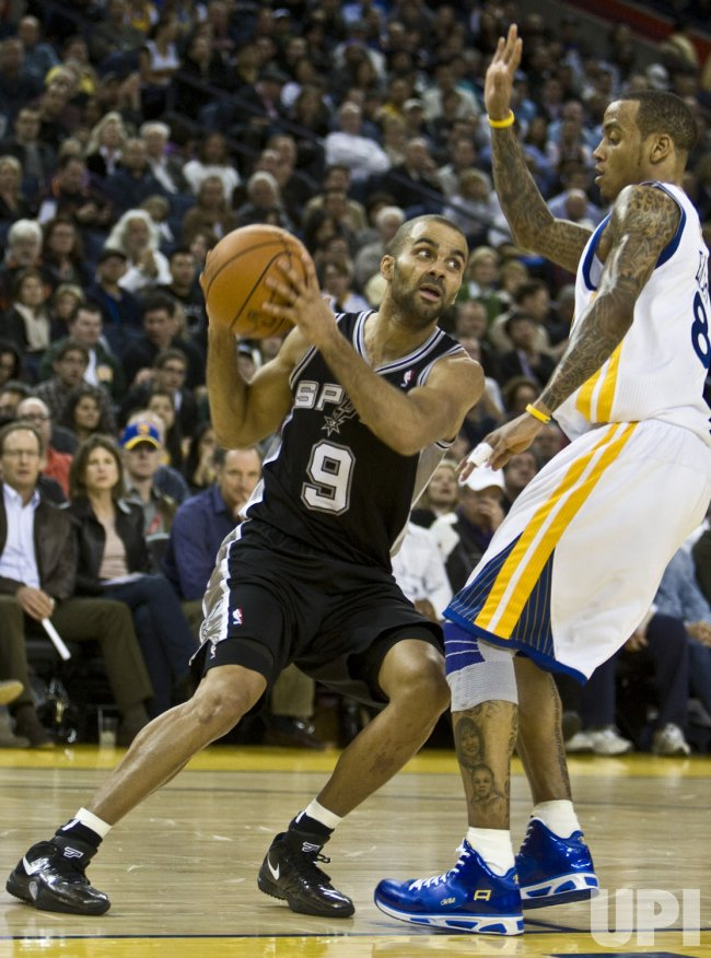 San Antonio Spurs Tony Parker is guarded by Golden State Warriors Monta Ellis in Oakland, California