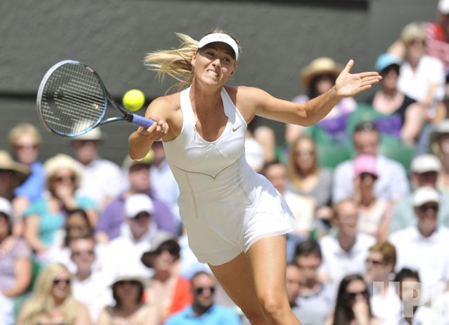 Maria Sharapova returns in the Women's Final at Wimbledon.