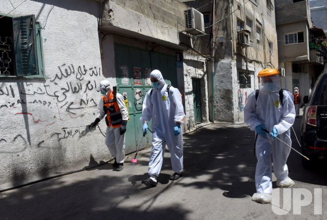 Palestinians Disinfect the Azza Refugee Camp In Bethlehem