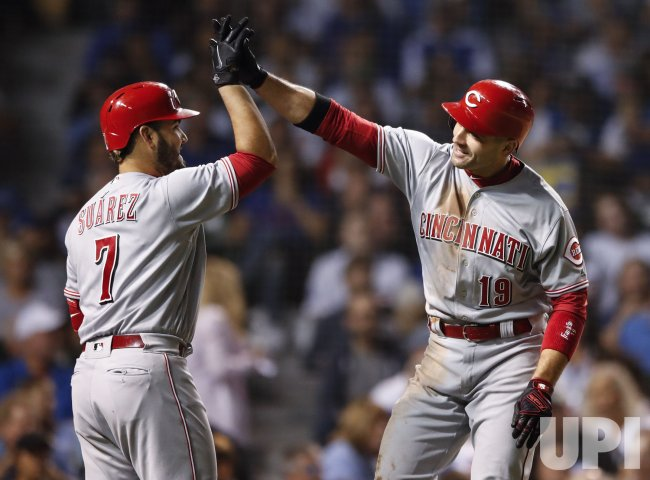 Reds Joey Votto hits solo home run against the Cubs in Chicago