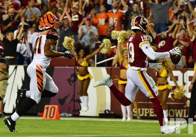 best service e36ba d2e96 Redskins' Robert Davis scores past Bengals' Trayvon ...