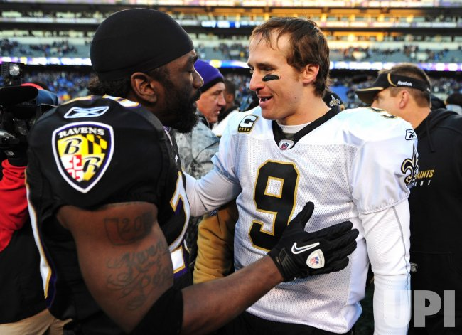 Saints' quarterback Drew Brees talks to Ravens safety Ed Reed in Baltimore