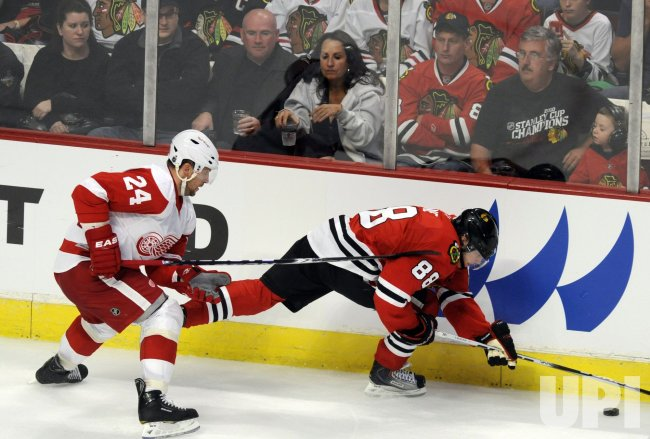 Blackhawks Patrick Kane and Red Wings Rusan Salei in Chicago