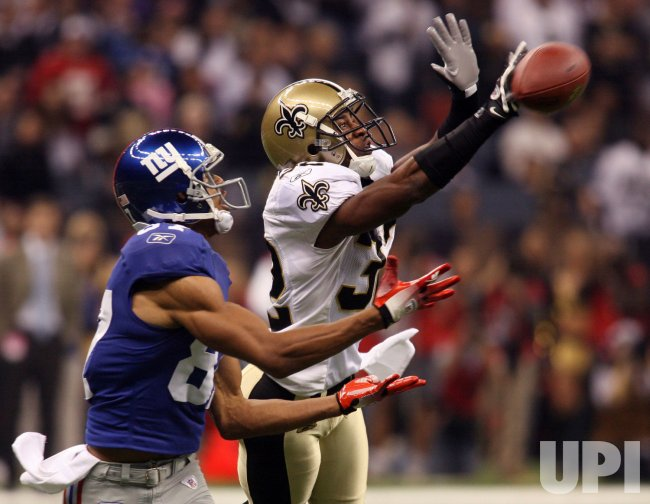 New York Giants pass broken up by New Orleans Saints defender at the Louisiana Superdome