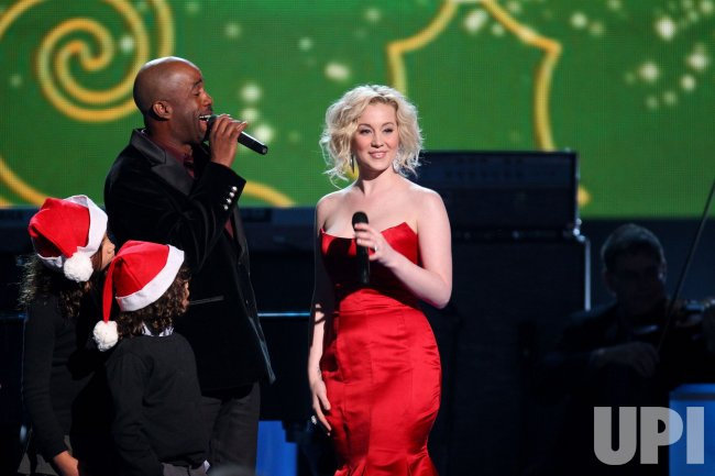 Kellie Pickler and Darius Rucker perform during the CMA Country Christmas Special in Nashville