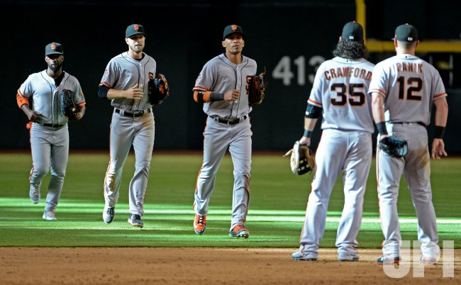Giants' McCutchen, Slater and Hernandez head in from outfield after win