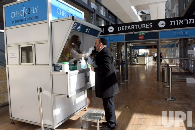 A Man Takes A Rapid COVID-19 Test In Ben Gurion Airport