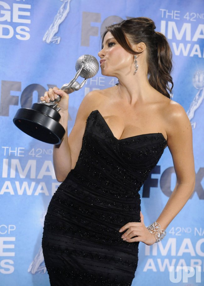 Sofia Vergara poses backstage with her award at the 42nd NAACP Image Awards Awards in Los Angeles
