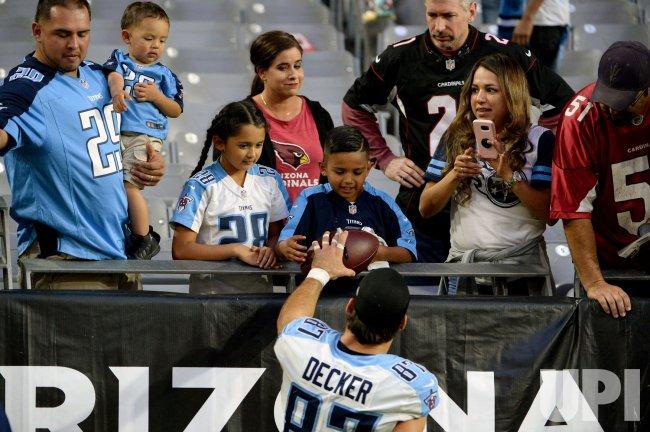 Titans' Decker gives a young fan a ball