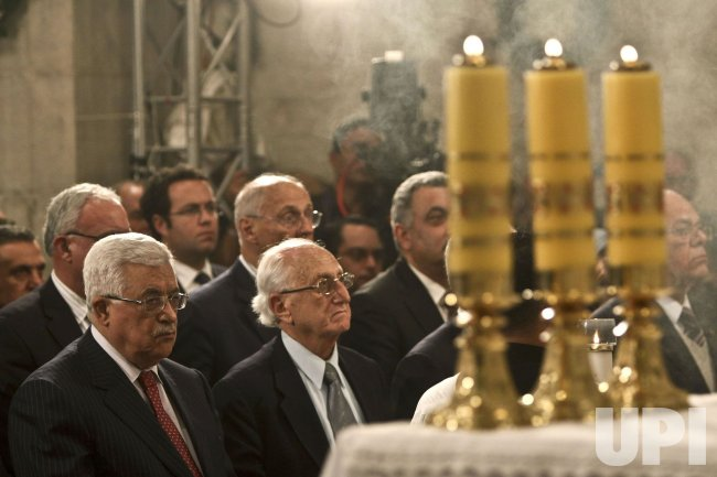 Palestinian President Mamoud Abbas attends Christmas midnight mass at the Church of the Nativity in Bethlehem