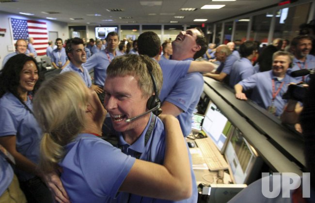 Jet Propulsion Laboratory team members celebrate Mars Rover's safe landing in Pasadena, California