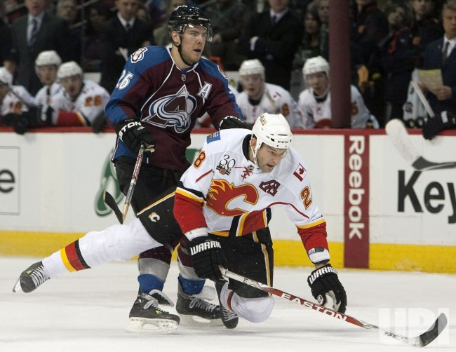 Avs Stastny Dumps Flames Regehr in Denver