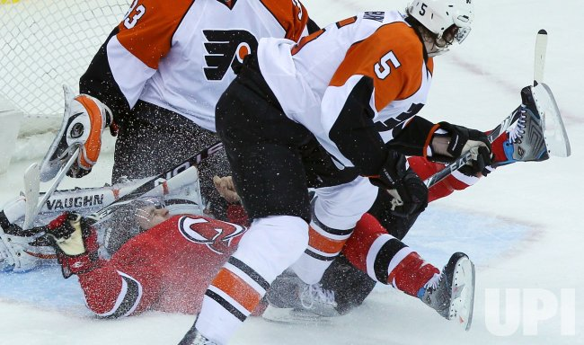New Jersey Devils Zach Parise falls down in the crease in the first period against the Philadelphia Flyers at Prudential Center in New Jersey