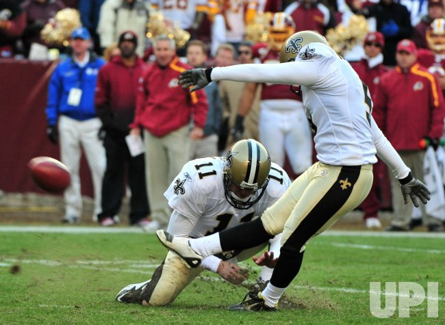 Saints' kicker Garrett Hartley kicks a field goal in Landover, Maryland