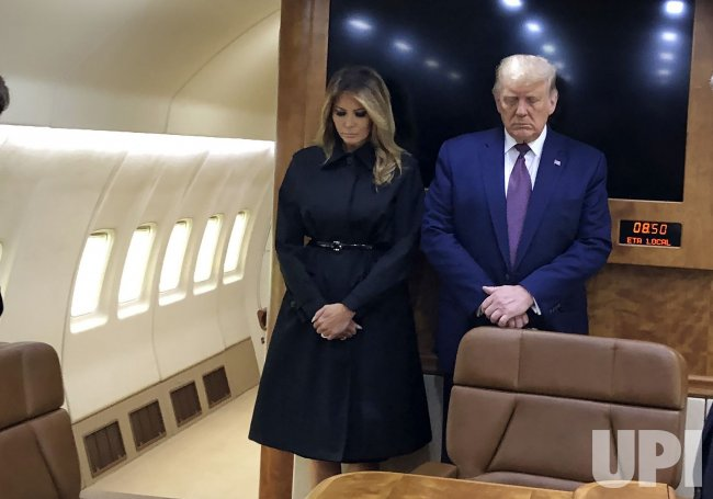 Trump Observes a Moment of Silence on Air Force One.