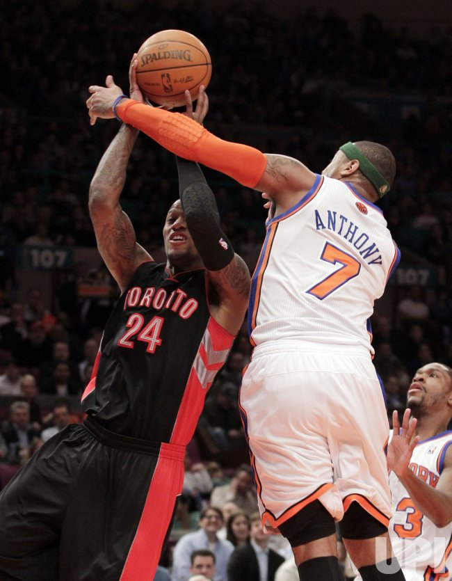 New York Knicks Carmelo Anthony plays defense on Toronto Raptors Sonny Weems at Madison Square Garden in New York