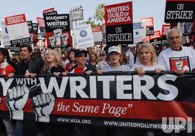 Striking writers joined by members of other unions in solidarity march in Los Angeles