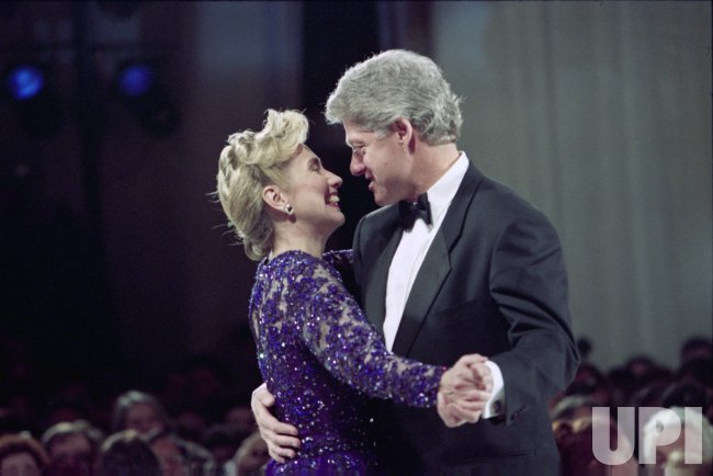 The Clintons dance at one of the 13 Inaugural Balls