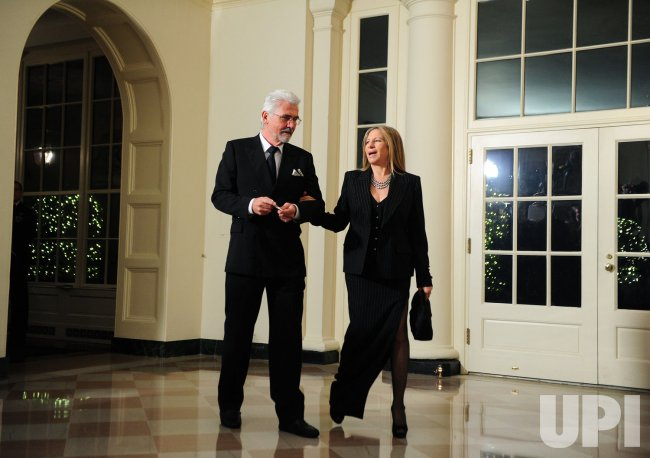 Barbra Streisand and James Brolin arrive for the State Dinner for President Hu Jintao of China in Washington