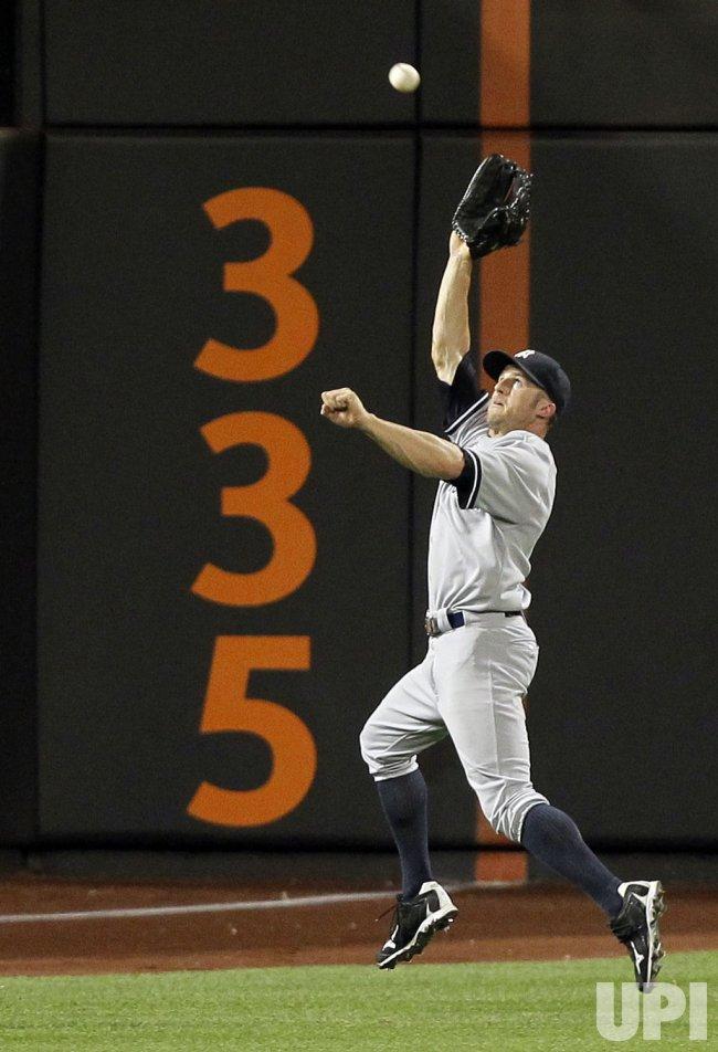 w York Yankees Brett Gardner makes a leaping catch at Citi Field in New York