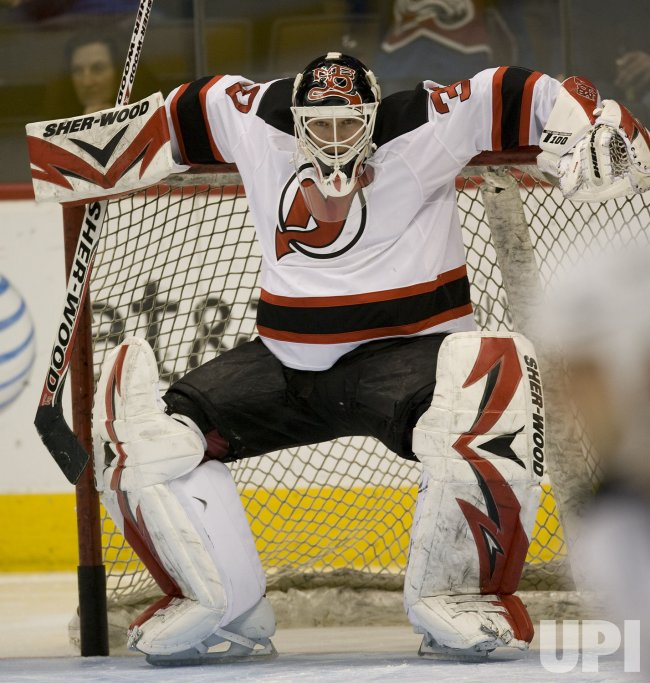 Devils Brodeur Stretches between Goalposts in Denver