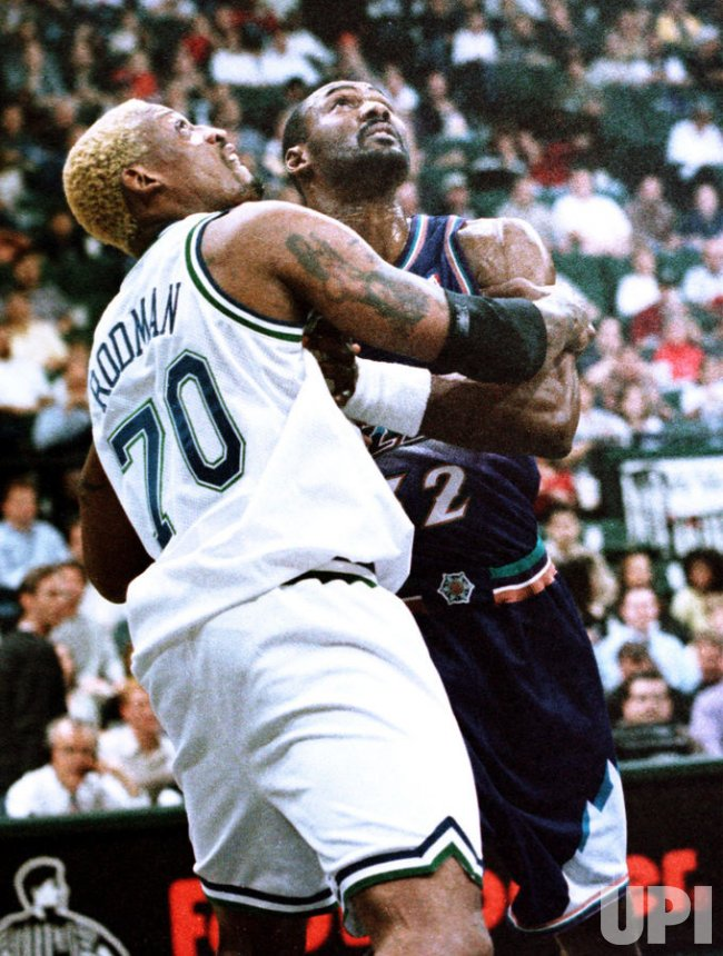 Dallas's Dennis Rodman and Utah's Karl Malone battle