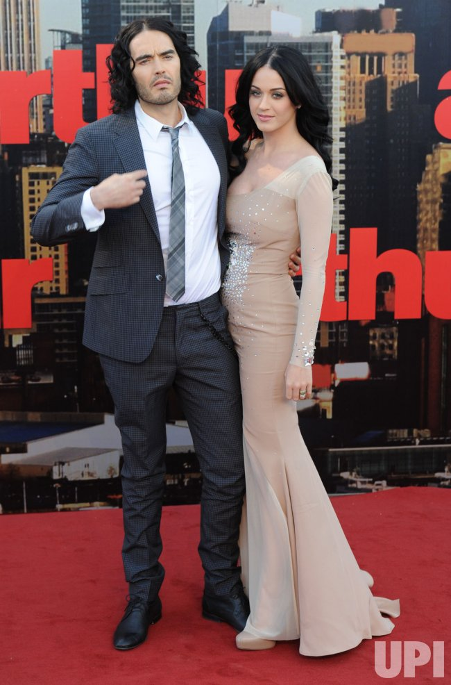 "Russell Brand and Katy Perry attend ""Arthur"" premiere"