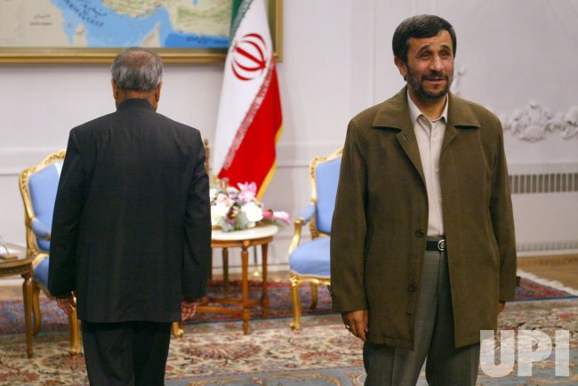 Iran's President Mahmoud Ahmadinejad meets Indian Foreign Minister Pranab Mukherjee in Tehran.