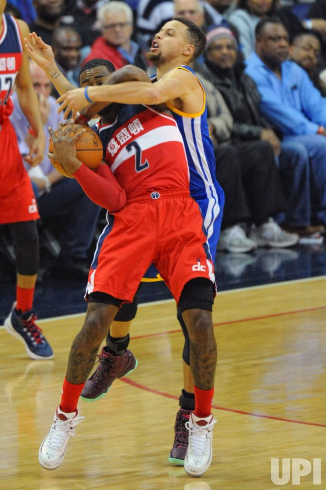 John Wall Fouled by Stephen Curry