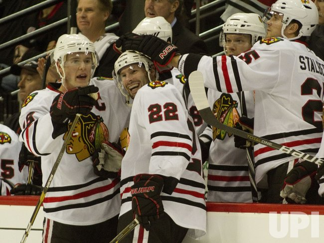 Blackhawks Celebrate Brouwer's Hat Trick in Denver