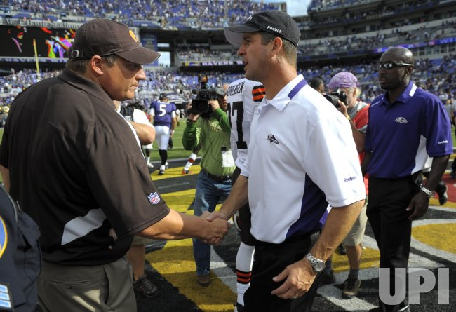 Baltimore Ravens' coach John Harbaugh shakes hands with Cleveland Browns coach Eric Mangini in Baltimore