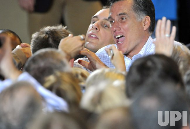 Mitt Romney works the crowd in Mesa, Arizona