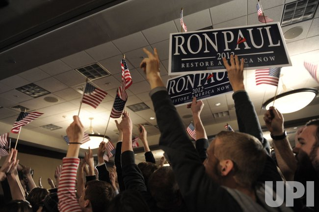 GOP presidential candidate Ron Paul attends a Caucus Night event in Ankeny,Iowa