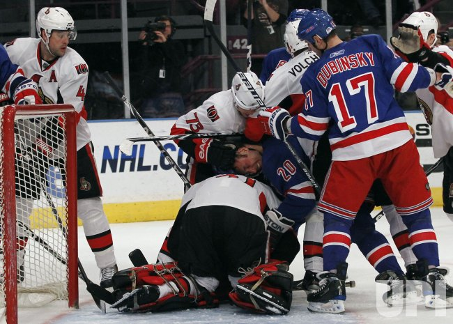 New York Rangers Vinny Prospal (20) gets his head pushed into the back of Ottawa Senators Mike broudeurat Madison Square Garden