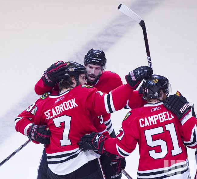 Blackhawks celebrate Seabrook goal during the 2010 Stanley Cup Final against the Flyers